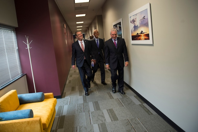 """Defense Secretary Ash Carter, left, tours the Boeing facility in St. Louis, Mo., as he arrives to speak with workers and kick off the Defense Advanced Research Projects Agency's """"Wait, What?"""" future technology forum, Sept. 9, 2015. DoD photo by U.S. Air Force Senior Master Sgt. Adrian Cadiz"""