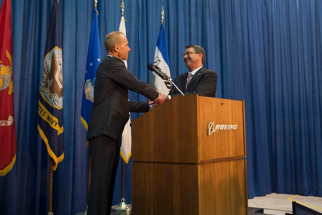 """Dennis Muilenburg, president and chief executive officer of The Boeing Company thanks Defense Secretary Ash Carter for coming to St. Louis, Mo., to speak with workers at Boeing, Sept. 9, 2015. Carter delivered remarks at the Defense Advanced Research Projects Agency's """"Wait, What?"""" future technology forum. DoD photo by U.S. Air Force Senior Master Sgt. Adrian Cadiz"""