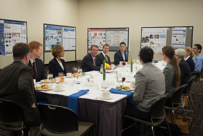 """Defense Secretary Ash Carter, center, speaks with a group Defense Advanced Research Projects Agency rising stars over lunch as he attends the DARPA """"Wait, What?"""" future technology forum in St. Louis, Mo., Sept. 9, 2015. DoD photo by U.S. Air Force Senior Master Sgt. Adrian Cadiz"""