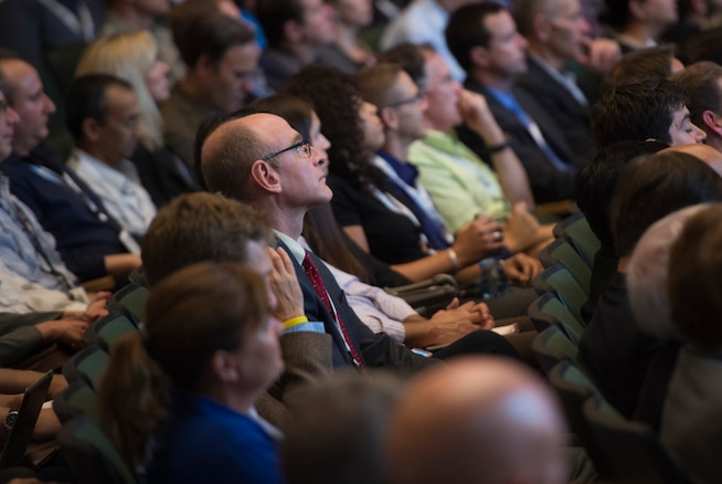 """Attendees of the Defense Advanced Research Projects Agency's """"Wait, What?"""" future technology forum listen as Defense Secretary Ash Carter gives remarks during the event at the America's Convention Center Complex in St. Louis, Mo., Sept. 9, 2015. DoD photo by U.S. Air Force Senior Master Sgt. Adrian Cadiz"""