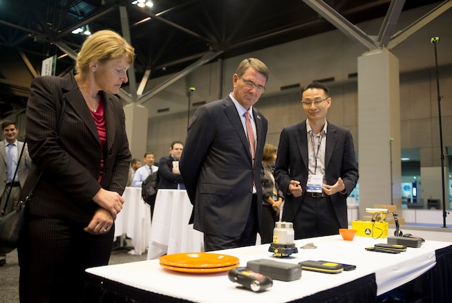 """Defense Secretary Ash Carter views one of the displays at the Defense Advanced Research Projects Agency """"Wait, What?"""" future technology forum at the America's Convention Center Complex in St. Louis, Mo., Sept. 9, 2015. DoD photo by U.S. Air Force Senior Master Sgt. Adrian Cadiz"""