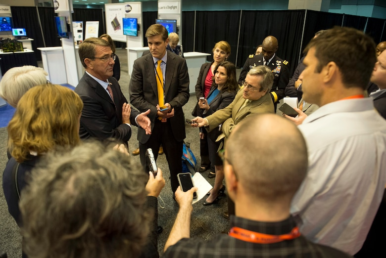 Defense Secretary Carter talking with reporters at DARPA forum on future technology