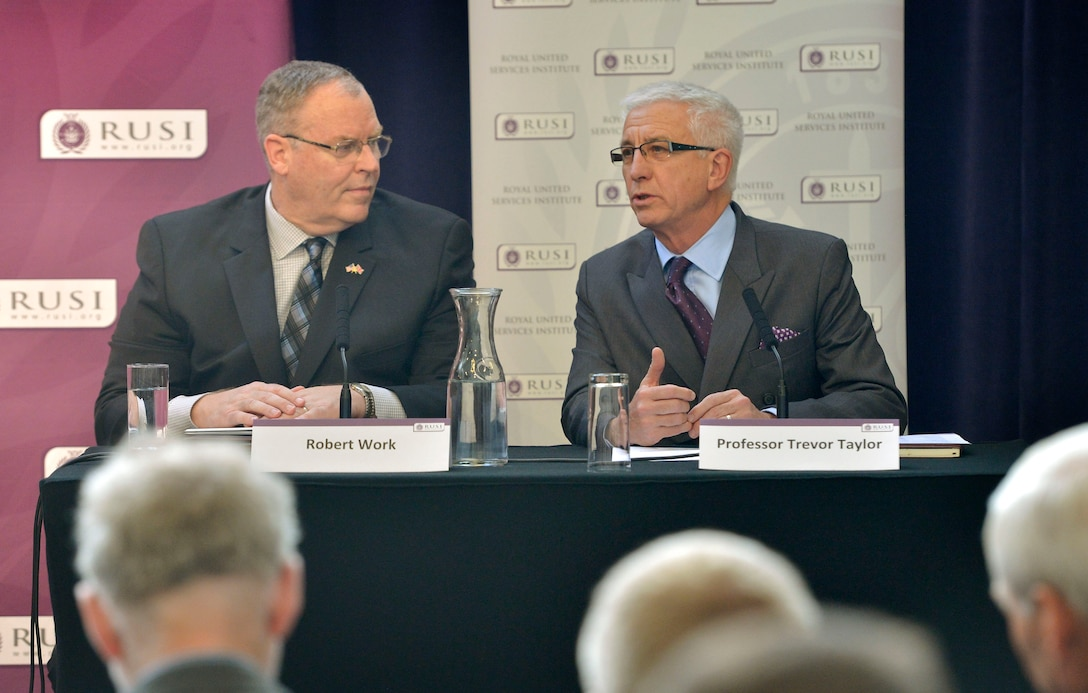 Trevor Taylor, right, professorial research fellow in defense management at the Royal United Services Institute for Defense and Security Studies, introduces U.S. Deputy Defense Secretary Bob Work, who delivered remarks to institute members in London, Sept. 10, 2015. DoD Photo by Glenn Fawcett