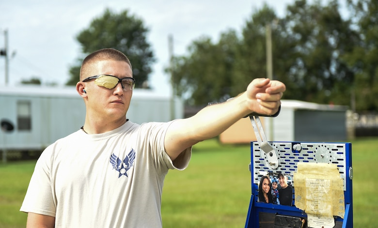 U.S. Air Force Staff Sgt. Jeremiah Jackson, 23d Equipment Maintenance Squadron aircraft metal technology craftsman and member of the Air Force National Pistol Team, visualizes the target during pistol shooting practice Sept. 4, 2015, in Valdosta, Ga. Jackson practices visualizing his shots to mentally prepare for every competition. (U.S. Air Force photo by Senior Airman Ceaira Tinsley/Released)