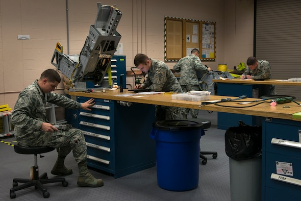 Airmen from the 23d Component Maintenance Squadron and 476th Maintenance Squadron perform inspections on ejection seats Sept. 2, 2015, at Moody Air Force Base, Ga. The egress Airmen maintain the seats from Moody's A-10C Thunderbolt II aircraft to help ensure the pilot's safety during an in-flight emergency. (U.S. Air Force photo by Airman 1st Class Kathleen D. Bryant/Released)