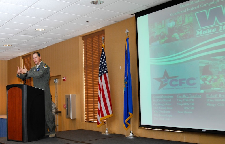 "U.S. Air Force Col. James Meger, 355th Fighter Wing commander, speaks to Desert Lightning Team Airmen during the Combined Federal Campaign kickoff breakfast at Davis-Monthan Air Force Base, Ariz., Sept. 10, 2015. The CFC is the only authorized solicitation of federal employees in the workplace on behalf of approved charitable organizations. The theme this year is ""You can change a life,"" last year the CFC raised $193 million for charitable causes worldwide. (U.S. Air Force photo by Staff Sgt. Angela Ruiz/Released)"
