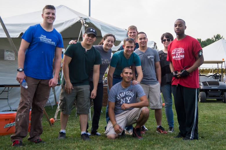 Scott Airmen volunteer for the 27th Midwest Salute to the Arts Aug. 27 and 30 at Everett Moody Park, Scott Air Force Base, Illinois. Airmen were in charge of setting-up and breaking-down the event. (U.S. photo by Airmen 1st Class Melissa Estevez)