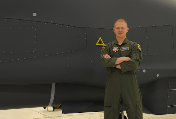 1st Lt. Peterson, 348th Reconnaissance Squadron, stands in front of a RQ-4 Globalhawk at Grand Forks Air Force Base, North Dakota, Sept. 8, 2014. Peterson was nominated by his command to be the Warrior of the Week for the second week of September. (U.S. Air Force photo by Senior Airman Desiree Economides/Released)