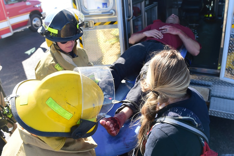 Bennett Fire Department first responders load a simulated casualty into the back of an ambulance Sept. 10, 2015, at Front Range Airport, Colo. A joint operation was conducted by Buckley Air Force Base personnel and surrounding community emergency responders during an annual major accident response exercise. (U.S. Air Force photo by Airman 1st Class Luke W. Nowakowski/Released)