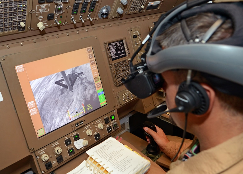 An Italian Air Force boom operator looks through a helmet-mounted display, which displays three-dimensional imagery of the boom, while refueling an F-35A during a sortie Sept. 2. Boom operators onboard the Italian AF KC-767A tanker use a remote vision system, which consists of two stereoscopic cameras on the bottom of the tanker, in order to refuel. (U.S. Air Force photo by Jet Fabara)