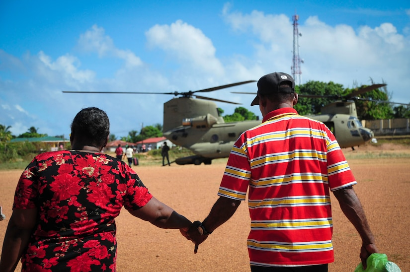 """TRUJILLO, Honduras – A man and woman from Gracias a Dios, a remote department in eastern Honduras, prepare to board a CH-47 """"Chinook"""" for a flight from Puerto Lempira to Trujillo, Honduras, Aug. 27, 2015. Joint Task Force-Bravo partnered with the Honduran Government to transport 25 patients and their escorts for eye care as part of Continuing Promise 2015, a U.S. Southern Command-sponsored exercise that builds partnership with nations throughout Central and South America and the Caribbean. (U.S. Air Force photo by Capt. Christopher Love)"""