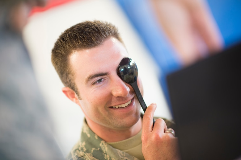 U.S. Air Force Airman 1st Class Daniel Rocheleau, of the Vermont Air National Guard, receives a vision exam with the 158th Fighter Wing Medical Squadron in South Burlington, Vt., June 6. The 158th Medical Squadron has become the first Air Guard base to process both Preventative Health Assessments and Occupational Health Physical Examinations in one large push, improving the medical experience for both sides, and creating a cost-saving and efficient format for other bases to emulate. (U.S. Air National Guard photo by Senior Airman Jon Alderman)