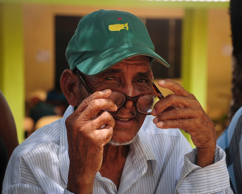TRUJILLO, Honduras – Benjamin Pamistan, a patient from the remote depart of Gracias a Dios in eastern Honduras, dons a pair of glasses he received during Continuing Promise 2015 in Trujillo, Honduras, Aug. 29, 2015. Pamistan began losing his sight three years ago and was chosen by the Honduran Government to receive eye care during the U.S. Southern Command-sponsored exercise in Trujillo. (U.S. Air Force photo by Capt. Christopher Love)