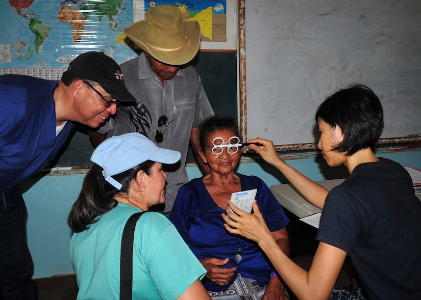 TRUJILLO, Honduras – Angela Brauman, a patient from the remote department of Gracias a Dios in eastern Honduras, receives an eye exam from U.S. Navy Lt. Serena Leung, U.S.N.S. Comfort optomologist, during Continuing Promise 2015 in Trujillo, Honduras, Aug. 28, 2015. Leung and Brauman communicated with the help of two separate translators, passing from English to Spanish to Misquito and back. (U.S. Air Force photo by Capt. Christopher Love)
