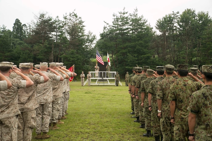 U.S. Marines and Japanese Ground Self Defense Force members salute as each nations' national anthem plays marking the beginning of Forest Light 16-1 at Camp Imazu, Takashima, Japan, Sept. 6, 2015. Forest Light will take place Sept. 7-18 with approximately 240 Marines working next to 350 JGSDF members. The exercise will consist of combined mortar live fire, establishing forward arming and refueling points, combined helicopter borne skills and combined-arms training. The JGSDF members are from 50th Infantry Regiment, 14th Brigade. The Marines are with 1st Battalion, 2nd Marine Regiment currently assigned to 4th Marine Regiment, 3rd Marine Division, III Marine Expeditionary Force.