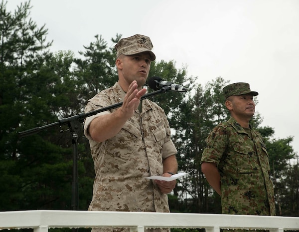 Lt. Col. Eric Reid, left, speaks to the Japanese Ground Self Defense Force and U.S. Marines during the opening ceremony of Forest Light 16-1 at Camp Imazu, Takashima, Japan, Sept. 6, 2015. Forest Light will take place Sept. 7-18 with approximately 240 Marines working next to 350 JGSDF members. The exercise will consist of combined mortar live fire, establishing forward arming and refueling points training, combined helicopter borne skills and combined-arms training. The JGSDF members are from 50th Infantry Regiment, 14th Brigade. The Marines are with 1st Battalion, 2nd Marine Regiment currently assigned to 4th Marine Regiment, 3rd Marine Division, III Marine Expeditionary Force.