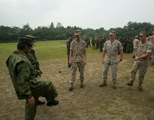 U.S. Marines and Japanese Ground Self-Defense members play Hacky Sack after the opening ceremony of Forest Light 16-1 at Camp Imazu, Takashima, Japan, Sept. 6, 2015. Forest Light will take place Sept. 7-18 with approximately 240 Marines working next to 350 JGSDF members. The exercise will consist of combined mortar live fire, establishing forward arming and refueling points training, combined helicopter borne skills and combined-arms training. The JGSDF members are from 50th Infantry Regiment, 14th Brigade. The Marines are with 1st Battalion, 2nd Marine Regiment currently assigned to 4th Marine Regiment, 3rd Marine Division, III Marine Expeditionary Force.