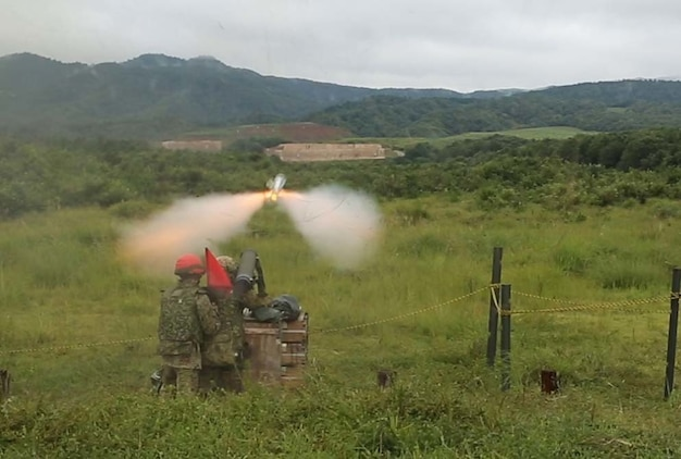 Sgt. Sugimoto Yoshitaka, fires the Type 01 LMAT Anti-Tank Missile System during Forest Light 16-1 at Camp Imazu, Takashima, Japan, Sept. 7, 2015. The Japanese Ground Self-Defense Force and U.S. Marines shared knowledge about different anti-tank missile systems. After giving specifications of their respective weapon systems, the two forces used practice rounds to demonstrate how well the weapon systems work. Forest Light will take place Sept. 7-18 with approximately 240 Marines working next to 350 JGSDF members. The exercise will consist of mortar live fire, establishing forward arming and refueling points training, helicopter borne skills and combined-arms training. Yoshitaka is an anti-tank missile man with 50th Infantry Regiment, 14th Brigade.