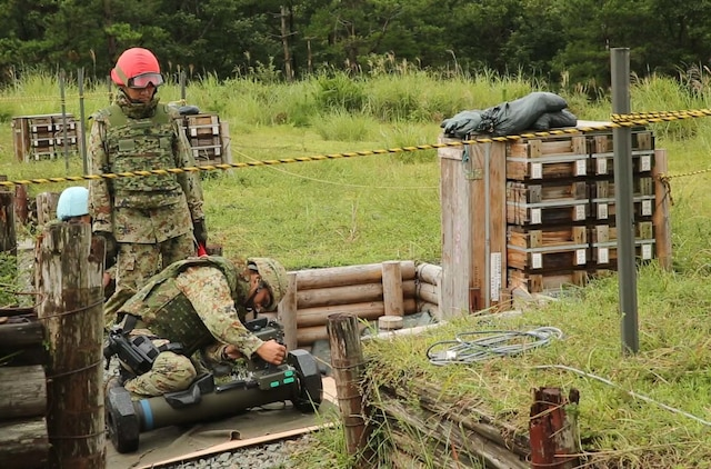 Sgt. Sugimoto Yoshitaka, front, preps the Type 01 LMAT Anti-Tank Missile System while Sgt. 1st Class Haya Yoshihiro watches to ensure proper preparation of the missile during Forest Light 16-1 at Camp Imazu, Takashima, Japan, Sept. 7, 2015. The Japanese Ground Self-Defense Force and U.S. Marines shared knowledge about different anti-tank missile systems. After giving specifications of their respective weapon systems, the two forces used practice rounds to demonstrate how well the weapon systems work. Forest Light will take place Sept. 7-18 with approximately 240 Marines working next to 350 JGSDF members. The exercise will consist of mortar live fire, establishing forward arming and refueling points training, helicopter borne skills and combined arms procedures. Yoshitaka is an anti-tank missile man with 50th Infantry Regiment, 14th Brigade. Yoshihiro is an anti-tank missile man with 50th Infantry Regiment, 14th Brigade.