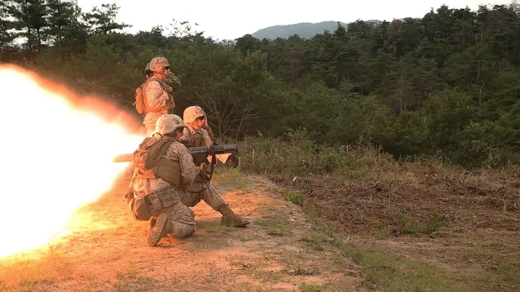 Cpl. Brandon Crain yells fire to Lance Cpl. Clayton Baker while demonstrating the capabilities of the shoulder-launched multipurpose assault weapon to the Japanese Ground Self-Defense Force during Forest Light 16-1 at Camp Imazu, Takashima, Japan, Sept. 7, 2015. The JGSDF and U.S. Marines took turns sharing knowledge about different anti-tank missile systems. After giving specifications of their respective weapon systems, the two forces used practice rounds to demonstrate how well the weapon systems work. Forest Light will take place Sept. 7-18 with approximately 240 Marines working next to 350 JGSDF members. The exercise will consist of mortar live fire, establishing forward arming and refueling points training, helicopter borne skills and combined arms procedures. Crain is from Leander, Texas and Baker is from Huntington, Indiana. Both Marines are assaultmen with 1st Battalion, 2nd Marine Regiment currently assigned to 4th Marine Regiment, 3rd Marine Division, III Marine Expeditionary Force.