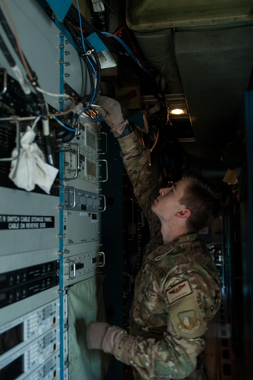 U.S. Air Force Airman 1st Class Chase Krol, 41st Expeditionary Electronic Combat Squadron airborne maintenance technician, completes a post-flight inspection on an EC-130H Compass Call aircraft at Bagram Airfield, Afghanistan, Sept. 6, 2015. The Compass Call is an airborne tactical weapon system using a heavily modified version of the C-130 Hercules airframe. (U.S. Air Force photo by Tech. Sgt. Joseph Swafford/Released)