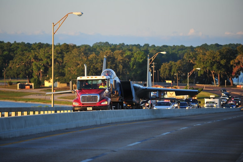 An F-15C Eagle is transported across the DuPont Bridge near Tyndall Air Force Base, Fla., Aug. 30, 2015. The F-15 was transported to Haney Technical Center to be used to train future aircraft mechanics in their Aviation Academy. (U.S. Air Force photo/Airman 1st Class Dustin Mullen)