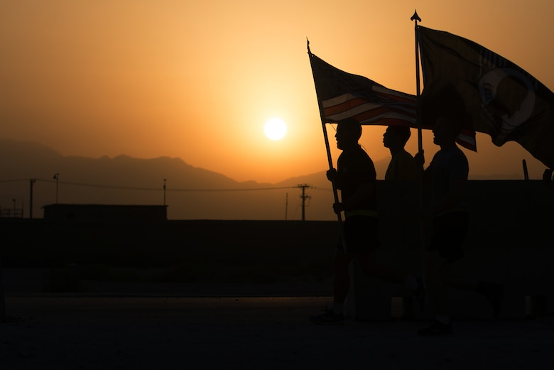 Service members participate in a prisoner of war/missing in action run at Bagram Airfield, Afghanistan, Sept. 4, 2015. For 24 consecutive hours, Bagram service members kept the POW/MIA flag in constant motion in honor of American POWs and those MIA. (U.S. Air Force photo/Tech. Sgt. Joseph Swafford)