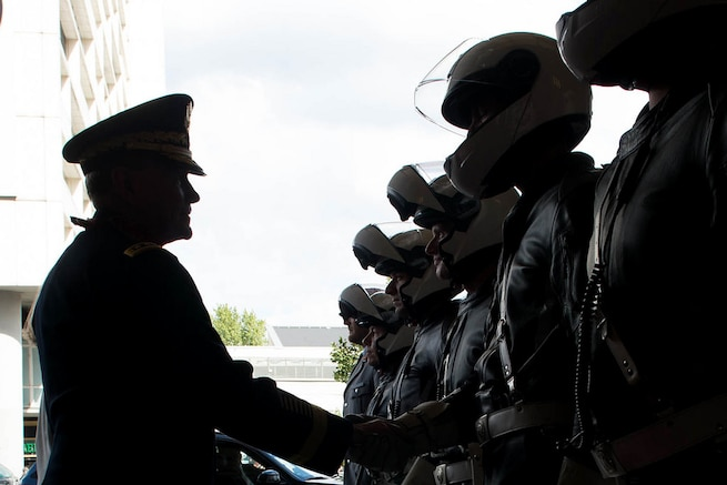 U.S. Army Gen. Martin E. Dempsey, chairman of the Joint Chiefs of Staff, thanks the German police officers who helped support his visit in Berlin, Sept. 10, 2015. DoD photo by D. Myles Cullen