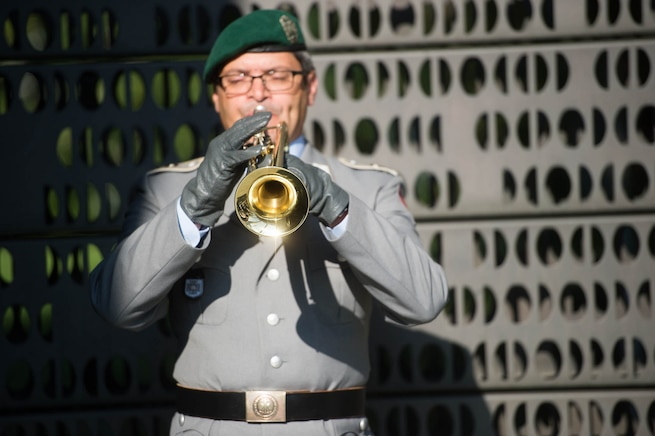 A German soldier plays the trumpet at the German memorial for their fallen service members while U.S. Army Gen. Martin E. Dempsey, chairman of the Joint Chiefs of Staff, presents a wreath in Berlin,, Sept. 10, 2015. DoD photo by D. Myles Cullen