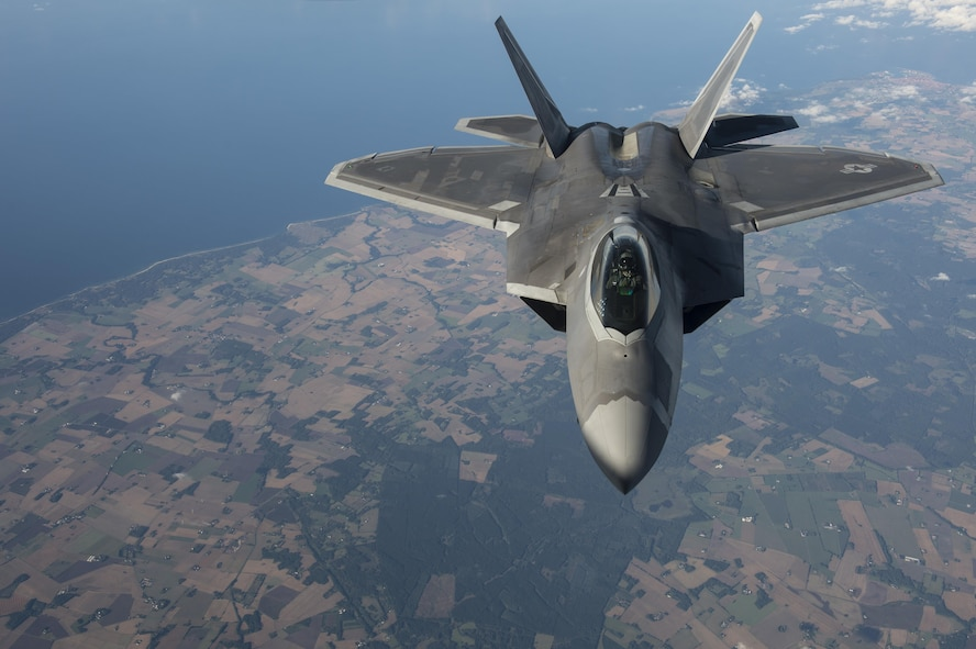 An F-22 Raptor from the 95th Fighter Squadron based at Tyndall Air Force Base, Fla., flies over Tallinn, Estonia, Sept. 4, 2015. The Air Force deployed four F-22s, a C-17 Globemaster III and approximately 60 Airmen and their associated equipment to Spangdahlem Air Base, Germany. While the aircraft and Airmen are in Europe, they will conduct air training with other Europe-based aircraft. (U.S. Air Force photo/Tech. Sgt. Jason Robertson)