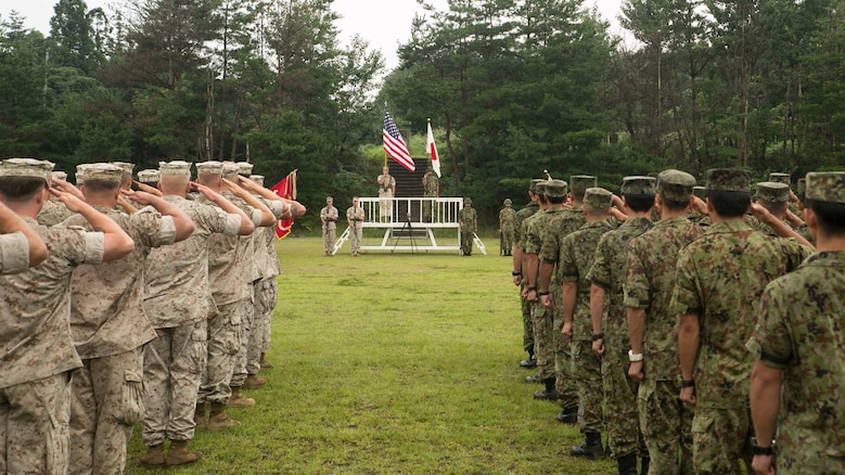 U.S. Marines and Japan Ground Self Defense Force members salute as each nations' national anthem plays marking the beginning of Forest Light 16-1 at Camp Imazu, Takashima, Japan, Sept. 6, 2015. Forest Light will take place Sept. 7-18 with approximately 240 Marines working next to 350 JGSDF members. The exercise will consist of combined mortar live fire, establishing forward arming and refueling points, combined helicopter borne skills and combined-arms training. The JGSDF members are from 50th Infantry Regiment, 14th Brigade. The Marines are with 1st Battalion, 2nd Marine Regiment currently assigned to 4th Marine Regiment, 3rd Marine Division, III Marine Expeditionary Force.