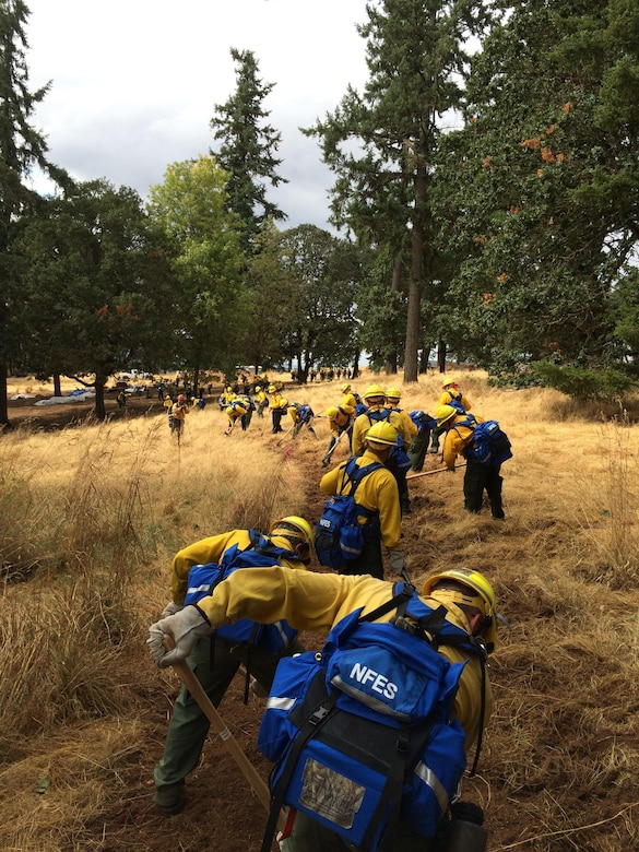 Members of the Oregon Air National Guard are training on equipment they will be using while assisting the wildland firefighters in cleanup operations Aug. 29, 2015 in Salem, Ore. To assist with firefighting efforts across the state, 125 Oregon ANG members were activated by the governor. Fifty-four of those Airmen were from the 173rd Fighter Wing at Kingsley Field, Ore. (U.S. Air National Guard photo)