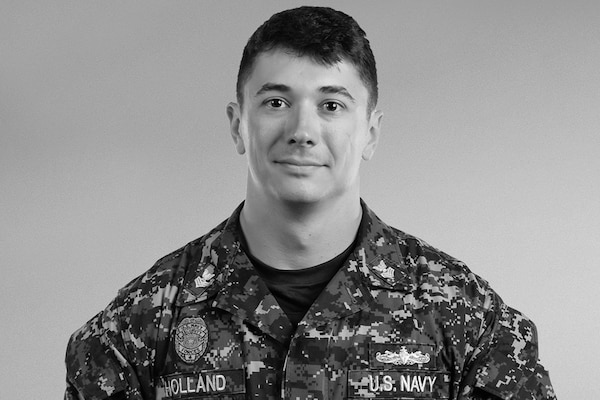 Navy Petty Officer First Class Ethan Holland, a master-at-arms assigned to the 628th Security Forces Squadron at Joint Base Charleston, S.C., recently became the first sailor to qualify as an Air Force security forces squadron flight chief. U.S. Air Force photo
