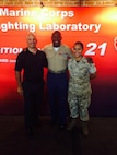 The Sergeant Major of the Marine Corps takes time to pose with SSgt Mayra Infante and Kyle Olson at the Marine Corps Warfighting Laboratory's booth during Marine Week Phoenix.
