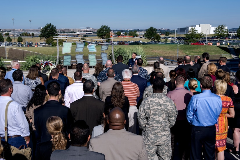 DIA employees join Air Force Reserve Chaplain Col. William Evans today at the agency's 9/11 Memorial for a moment of silence to honor colleagues and friends lost in the 2001 attacks.