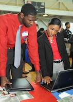 Huntsville Center Workforce Development Specialist Atidya Williams shows Gerald Phillips, a graduate student at the University of Alabama in Huntsville, tips to navigate the USAJOBS website during the UAH Career Fair Sept. 10. Huntsville Center staff will next be at the Alabama A&M University Career Fair 10 a.m.-2 p.m. Oct. 1 in Huntsville.