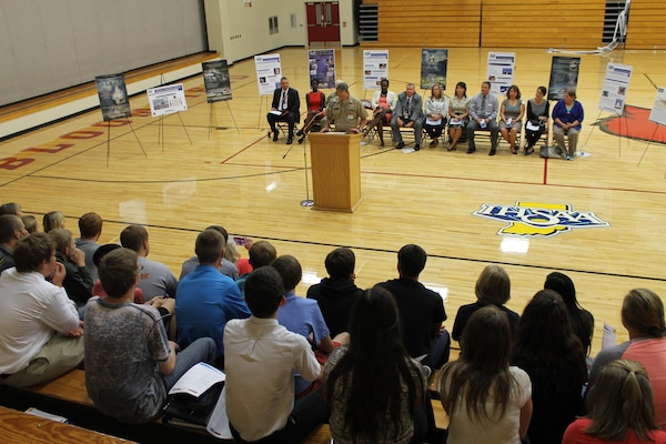 BLOOMFIELD, Indiana - Naval Surface Warfare Center, Crane Division (NSWC Crane) has partnered with the DirectEmployers Foundation, Bloomfield Jr./Sr. High School and Indiana University's Center for P-16 Research and Collaboration to put personnel into the classroom as part of a total immersion project designed to bring the naval installation into the school system.  Representatives from each of the partner organizations met with students at the school on Tuesday, Sept. 8 to explain the new business simulation pilot program, which will immerse kids in a corporate environment while augmenting their Science, Technology, Engineering and Mathematics (STEM) education.