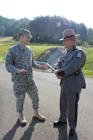 U.S. Army Corps of Engineers Baltimore District commander Col. Ed Chamberlayne (left) honors New York State Trooper Donald Atkinson with a coin and certificate of appreciation for heroically saving a young girl's life in July at Whitney Point Dam.