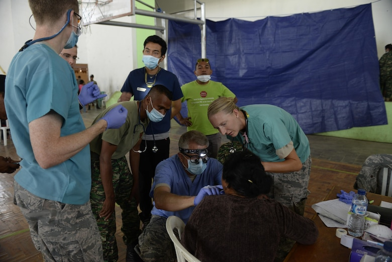 Pacific Angel 15-2 general practice physicians and dentists take a look at a patient's oral sore during a health services outreach Sept. 11, 2015, in Baucau, Timor-Leste. Pacific Angel is a multilateral humanitarian assistance civil military operation, which improves military-to-military partnerships in the Pacific while also providing medical health outreach, civic engineering projects and subject matter exchanges among partner forces. (U.S. Air Force photo by Staff Sgt. Alexander W. Riedel/Released)