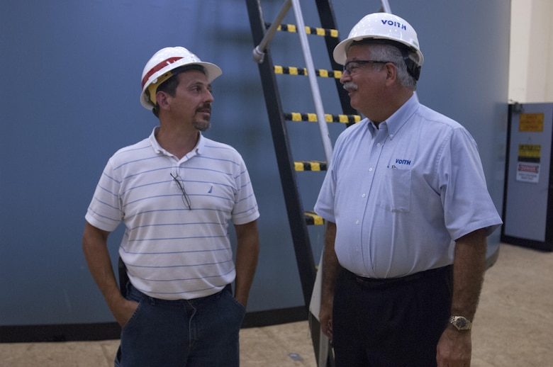 Jerry Lee (Left), mechanical engineer and project engineer for the U.S. Army Corps of Engineers Nashville District's Center Hill Hydropower Rehabilitation Project, talks with Bob Gallo, Voith Hydro chief executive officer, during his visit to the power house in Lancaster, Tenn., Sept. 9, 2015.