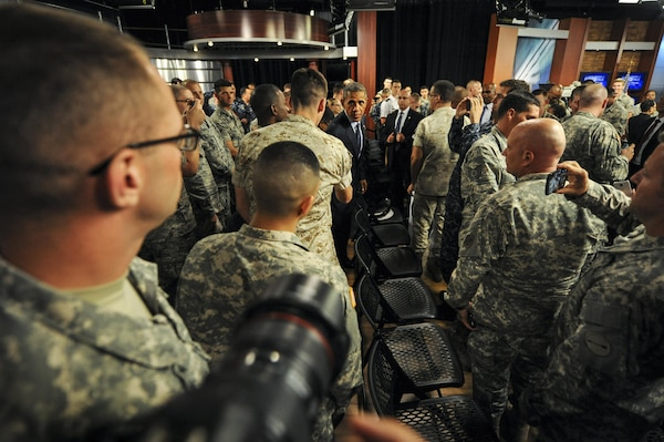 President Barack Obama greets service members before his worldwide troop talk from Fort Meade, Md., Sept. 11, 2015. Obama visited the base to conduct a live, televised troop talk with service members on the 14th anniversary of 9/11 from the Defense Media Activity studios. DoD photo by Marvin Lynchard