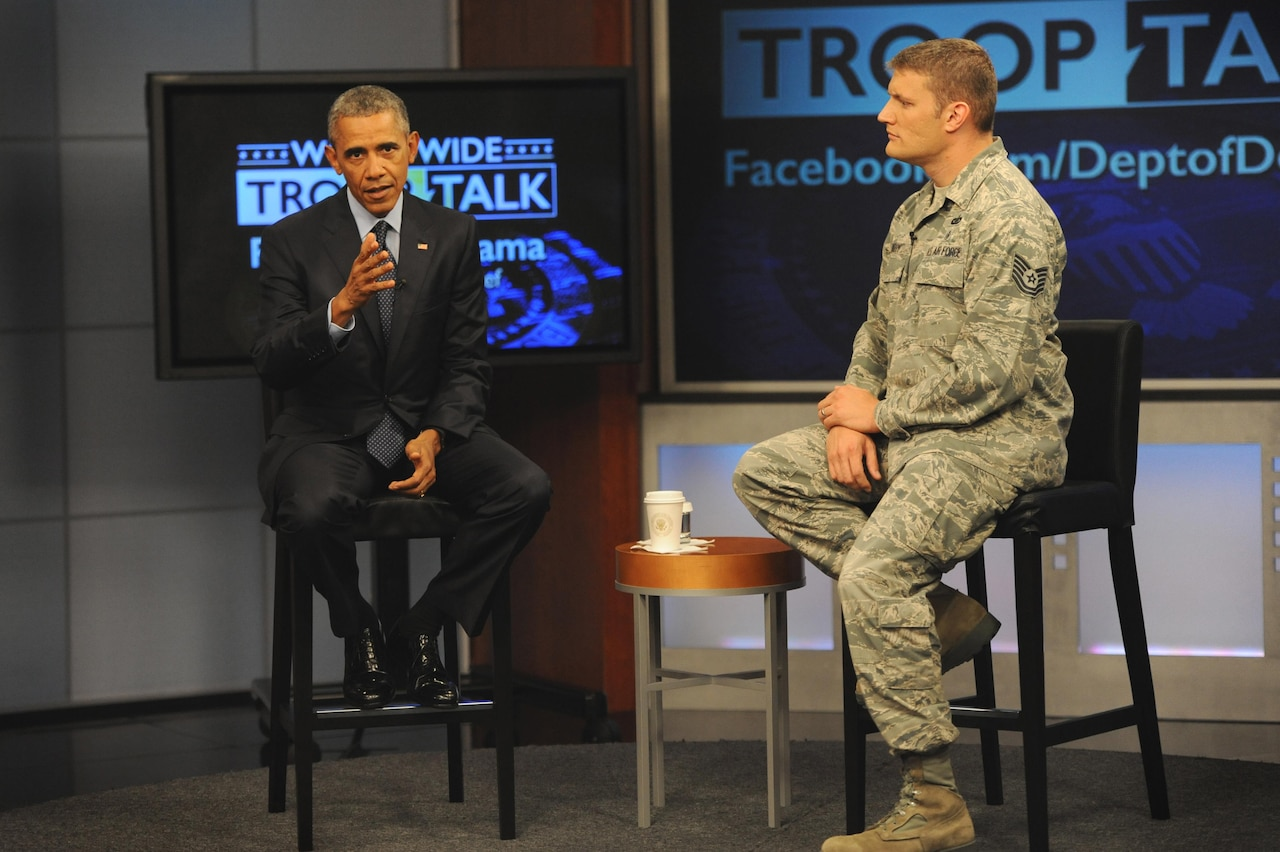 President Barack Obama sits with Air Force Tech Sgt. Nathan Parry, the moderator of the president's worldwide troop talk, on a set from Fort Meade, Md., Sept. 11, 2015. DoD photo by Marvin Lynchard