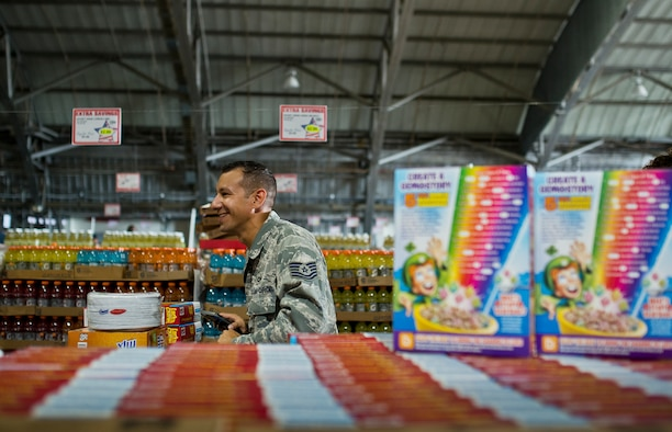 A technical sergeant moves his cart up the final aisle of deals at the commissary case lot sale at Duke Field, Fla., Sept. 11.  Patrons waited in line for at least 30 minutes to receive the special sales prices. The three-day sale was open to military, retirees, family members and had special hours for reservists. (U.S. Air Force photo/Tech. Sgt. Sam King)
