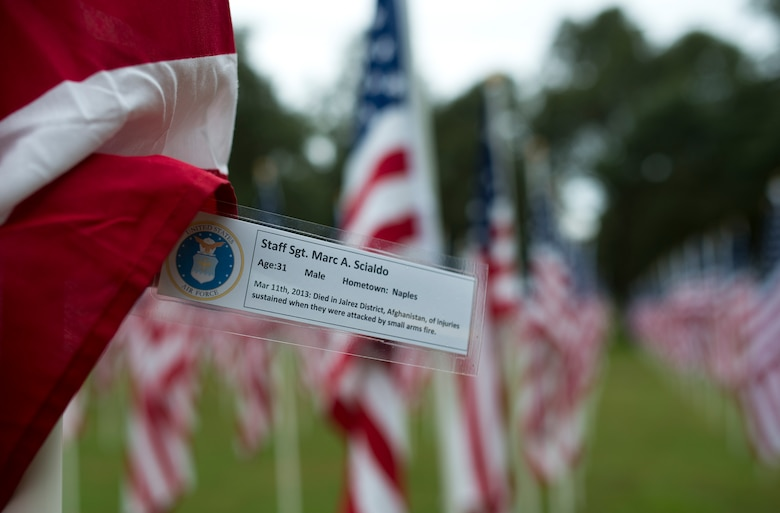 Staff Sgt. Marc Scialdo's name was attached to one of the flags set up on the Field of Valor display in Niceville, Fla. Sept. 11.  The display features 13 rows of 27 flags and one extra to create the field.  Names of recently fallen military members, including 10 Airmen, adorn each of the approximately 352 American flags.  The Field will be on display through Sept. 19 at the Mullet Festival grounds and is free to the public.  (U.S. Air Force photo/Tech. Sgt. Sam King)
