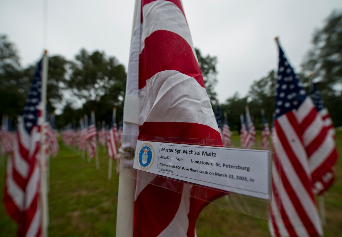 Master Sgt. Michael Maltz's name was attached to one of the flags set up on the Field of Valor display in Niceville, Fla. Sept. 11.  The display features 13 rows of 27 flags and one extra to create the field.  Names of recently fallen military members, including 10 Airmen, adorn each of the approximately 352 American flags.  The Field will be on display through Sept. 19 at the Mullet Festival grounds and is free to the public.  (U.S. Air Force photo/Tech. Sgt. Sam King)