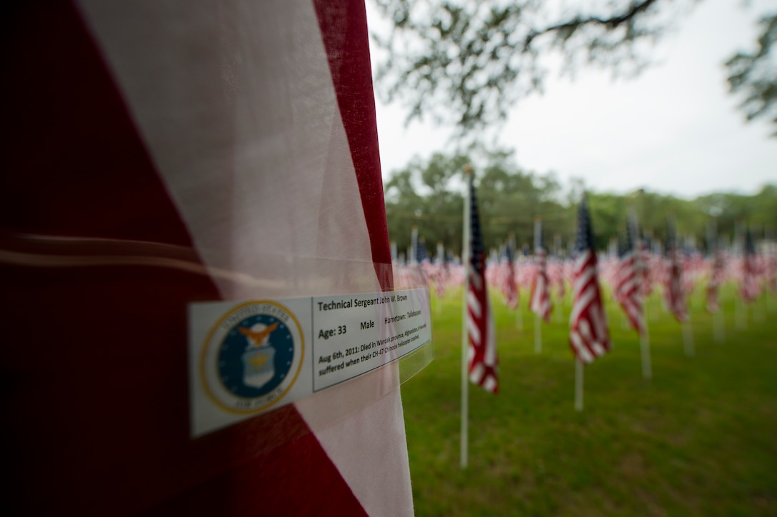 Tech. Sgt. John Brown's name was attached to one of the flags set up on the Field of Valor display in Niceville, Fla. Sept. 11.  The display features 13 rows of 27 flags and one extra to create the field.  Names of recently fallen military members, including 10 Airmen, adorn each of the approximately 352 American flags.  The Field will be on display through Sept. 19 at the Mullet Festival grounds and is free to the public.  (U.S. Air Force photo/Tech. Sgt. Sam King)