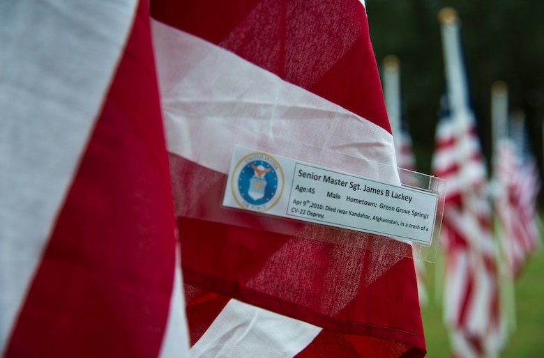 Senior Master Sgt. James Lackey's name was attached to one of the flags set up on the Field of Valor display in Niceville, Fla. Sept. 11.  The display features 13 rows of 27 flags and one extra to create the field.  Names of recently fallen military members, including 10 Airmen, adorn each of the approximately 352 American flags.  The Field will be on display through Sept. 19 at the Mullet Festival grounds and is free to the public.  (U.S. Air Force photo/Tech. Sgt. Sam King)