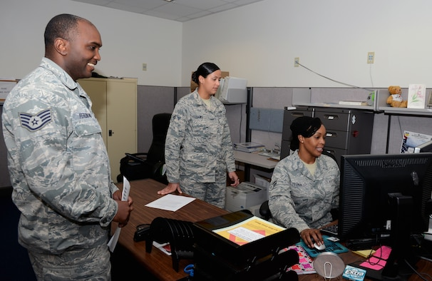 Airman 1st Class Vanessa Lewis and Airman 1st Class Aisha Tillman, 36th Force Support Squadron technicians, assist Staff Sgt. Robinson Ferdinand, 36th Civil Engineer Squadron, with updating his records Sept. 9, 2015, at Andersen Air Force Base, Guam. The awards and decorations office ensures achievements are rightfully given to service members and updates their records for career progression. (U.S. Air Force photo by Airman 1st Class Arielle Vasquez/Released)