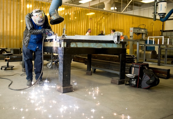 Rich Samanich, 57th Maintanence Group aircraft metals technology lead, cuts through metal at the Aircraft Metals Technology shop on Nellis Air Force Base, Nev., Sept. 3, 2015. Metals technology requires precision and attention to detail. (U.S. Air Force photo by Airman 1st Class Rachel Loftis)