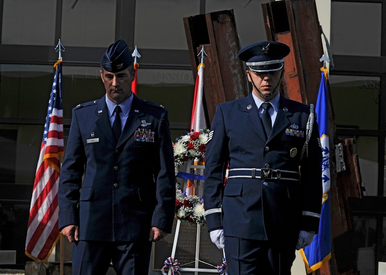 Col. John Ferry, 601st Air Operations Center Commander and Staff Sgt. Christopher Jones, 601st AOC Color Guard, depart after placing a wreath at the 601st  AOC 9/11 Memorial during a remembrance ceremony Sept. 11.  (Air Force Photo Released/Airman 1st Class Sergio Gamboa)